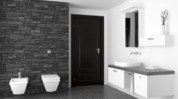 7232068 - modern bathroom with black stone wall and white equipment