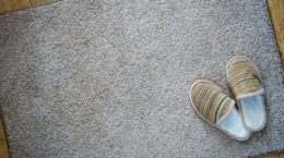 40824108 - slippers on the mat, top view with space for text