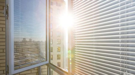 52823643 - opened window on sunny day with horizontal plastic blinds