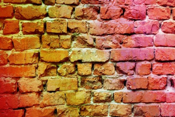 57440426 - colorful brick wall background