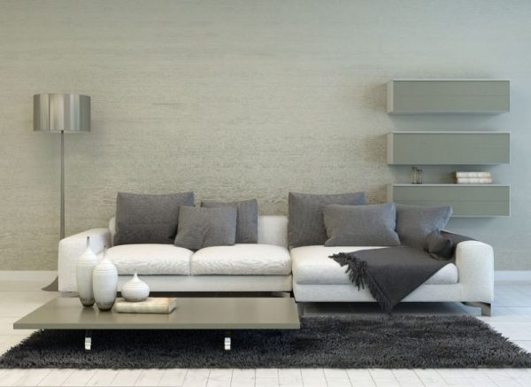 36673029 - modern grey and white living room with floor lamp, sofa, coffee table, and floating shelves