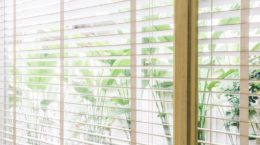 55017256 - selective focus point on blinds window decoration in livingroom interior - vintage light filter