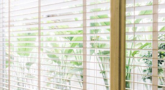 55017256 - selective focus point on blinds window decoration in livingroom interior - vintage light filter