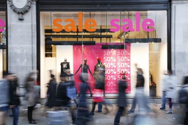 11853281 - sale signs in shop window, big reductions
