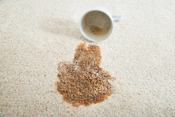 47217464 - close-up of coffee spilling from cup on carpet